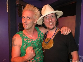 May 21 - New York - Supla loaned Sami Yaffa his big chest medallion after Supla's Brothers of Brazil band opened for Sami's Mad Juana at the Bowery Electric.