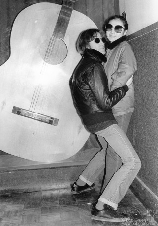 "In December of 1980, I was taking photos of John Lennon and Yoko Ono at the Record Plant studio in New York where they were mixing Yoko's 'Walking on Thin Ice' record. They are posing in front of the guitar that John Lennon made as an exhibit for an Avant Garde Festival in the early 1970s. John pushed Yoko up against the wall and turned to me and said, ""Get a photo of us like this. This is what people really want to see!"""