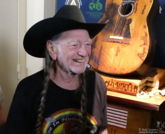 June 6 - New York - Willie Nelson looked happy to see his guitar shaped 80th birthday cake at the Hard Rock Cafe in Times Square.