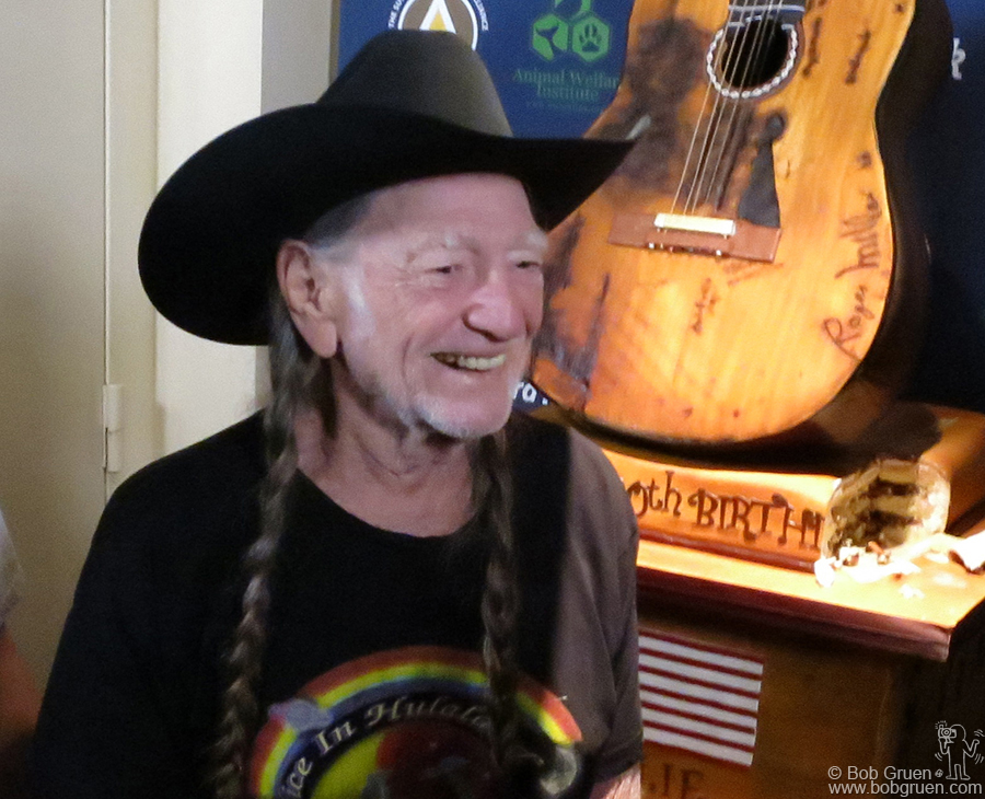 June 6 - NYC - Willie Nelson looked happy to see his guitar shaped 80th birthday cake at the Hard Rock Cafe in Times Square.