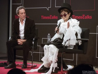 October 15 - New York City - Yoko Ono and Michael Kimmelman at a New York Times talk. Yoko is covered in gauze after a brief demonstration of one of her performance art pieces.