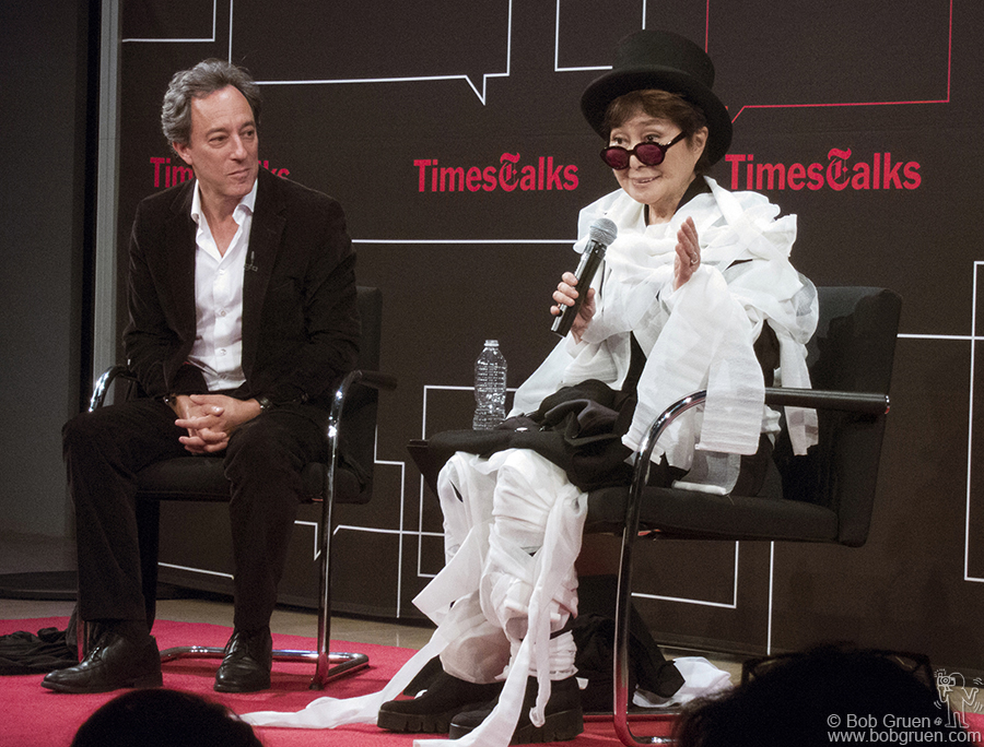 Oct 15 - NYC - Yoko Ono and Michael Kimmelman at a New York Times talk. Yoko is covered in gauze after a brief demonstration of one of her performance art pieces.