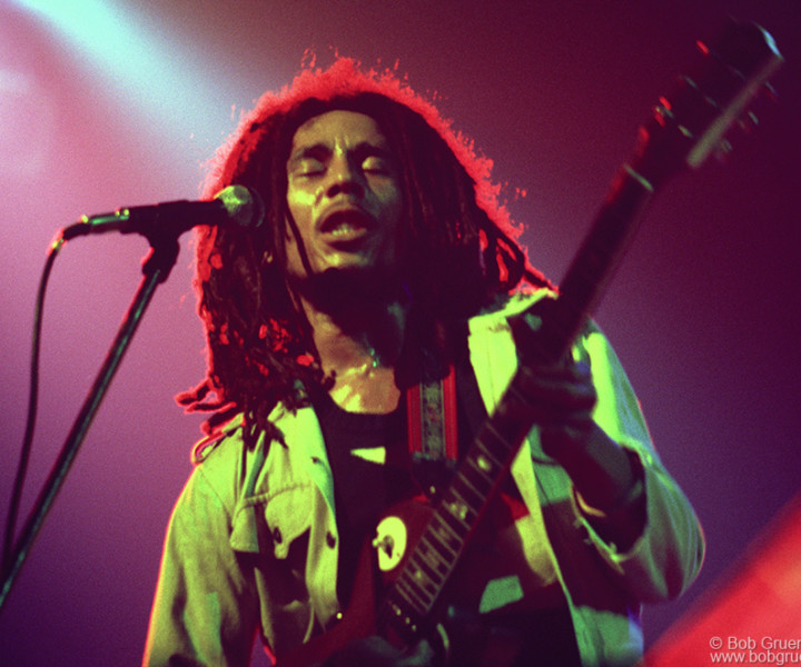 Bob Marley, the most important reggae singer in the world, looks great bathed in the yellow, red and green colors of the Rastafarian faith as he played at the Beacon Theatre.