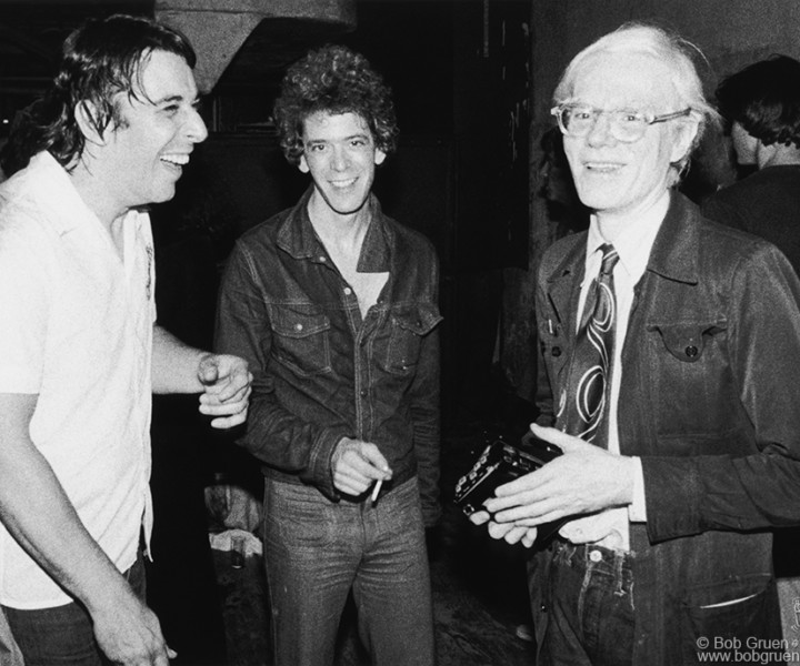 (L-R) John Cale, Lou Reed and Andy Warhol, Ocean Club, NYC. July 1976. <P>Image #: R-426  © Bob Gruen
