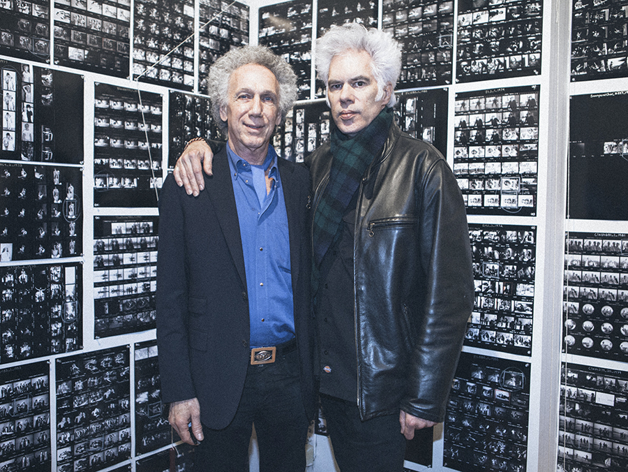 Jim Jarmusch came to check out the wall of contact prints which show the rest of the roll of film in which the exhibit photos come from. A lot of people were interested to see the outtakes of famous shots. Photo by Nicole Silver.