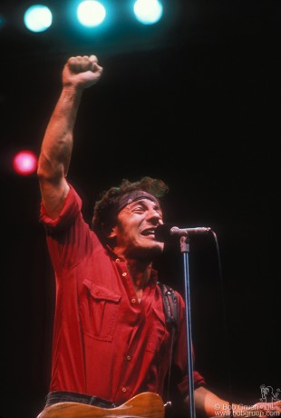 Bruce pumps his fist in the air in response to the cheering crowd at Exhibition Stadium Grandstand in Toronto.