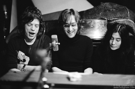 While visiting John & Yoko's recording session at the Record Plant in NYC Mick joined John & Yoko behind a piano to sing along on a song Yoko had just written and they seemed to all have a lot of fun together.