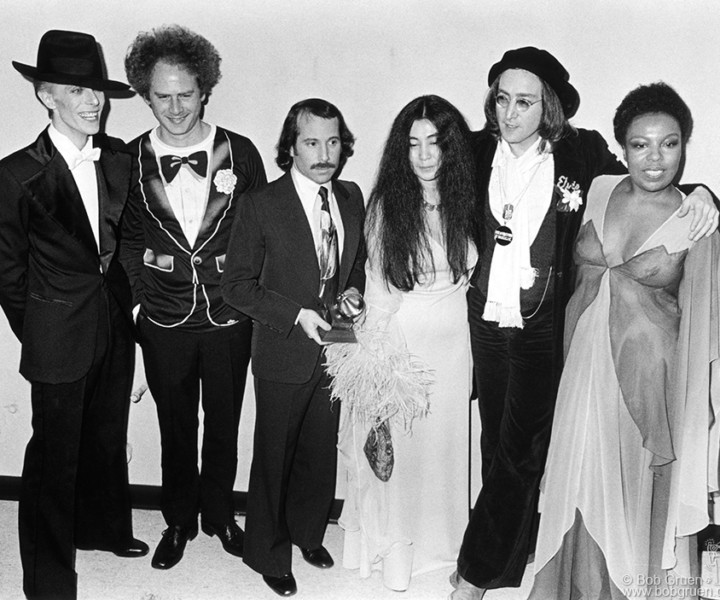 (L-R) David Bowie, Art Garfunkel, Paul Simon, Yoko Ono, John Lennon and Roberta Flack, NYC. March 1, 1975. <P>Image #: R-397  © Bob Gruen