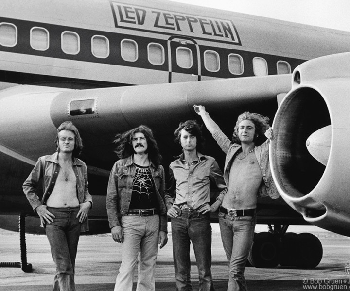 Led Zeppelin rented the Boeing 720 airplane for their 1973 tour. It had two bedrooms (one with an electric fireplace) and a brass bar with a piano built in. This photo represents the excess of the rock lifestyle in the 1970's.