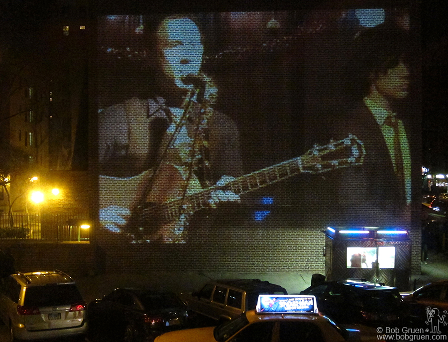 Dec 18 - NYC - My son Kris Gruen performed at The Treehouse at 2A, and they projected his live image on the wall of the buildings across the street!