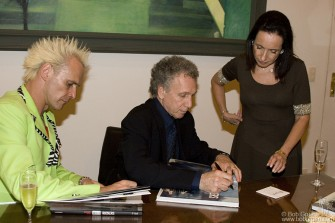 After the opening, Supla and Bob sign copies of 'Rockers' for Celita and her family.