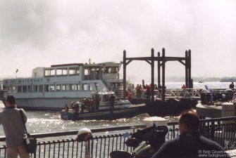 Ferry boats started arriving bringing victims from the city.
