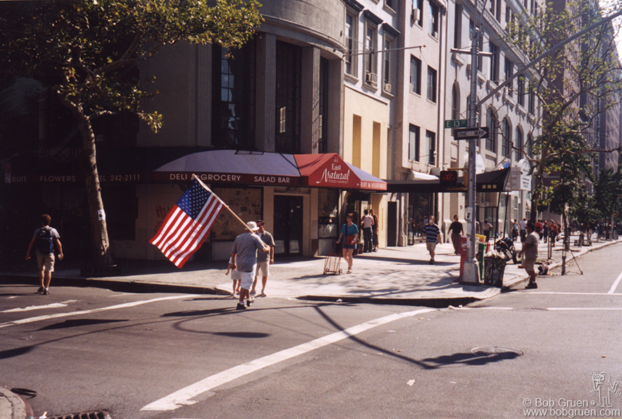 The day after the attack, I saw this man marching down Fifth Avenue with his flag. I realized many people would want to go to war and it made me very sad.