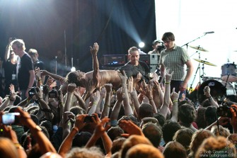 Iggy Pop was passed around by the crowd at the festival after the encore.