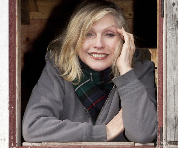 Debbie looks as cute as ever looking out of a country house window.
