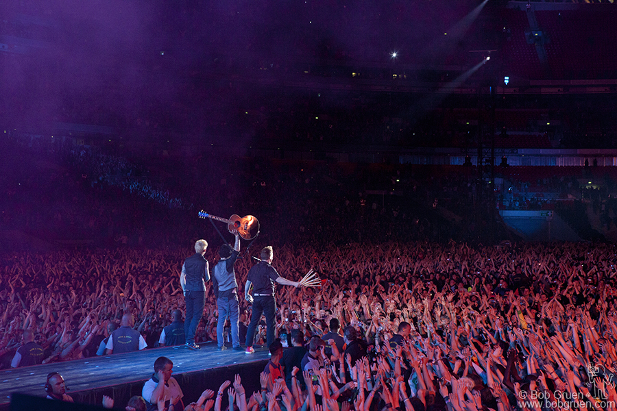Green Day acknowledges the wildly cheering fans at Wembley.