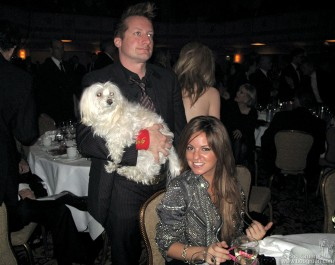 Tre Cool (with someone's dog) and his date watch the show.
