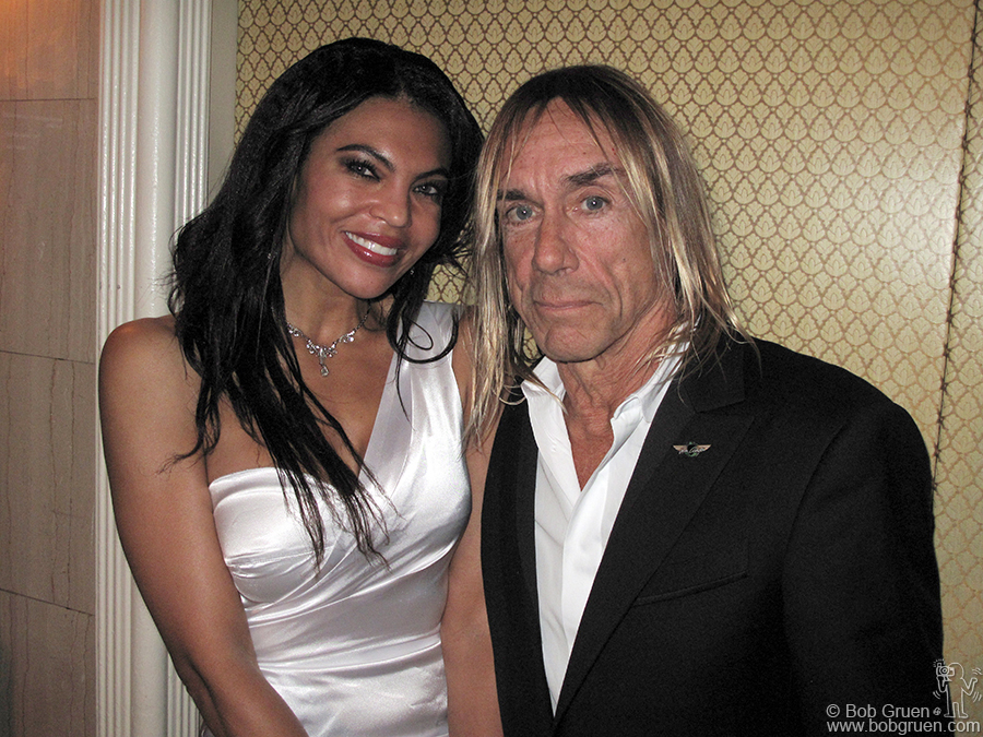 Iggy relaxes with his beautiful wife Nina after the show.