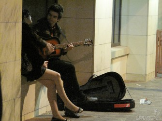 The music never stops at SXSW. Late at night a musician serenaded a young lady near my hotel.