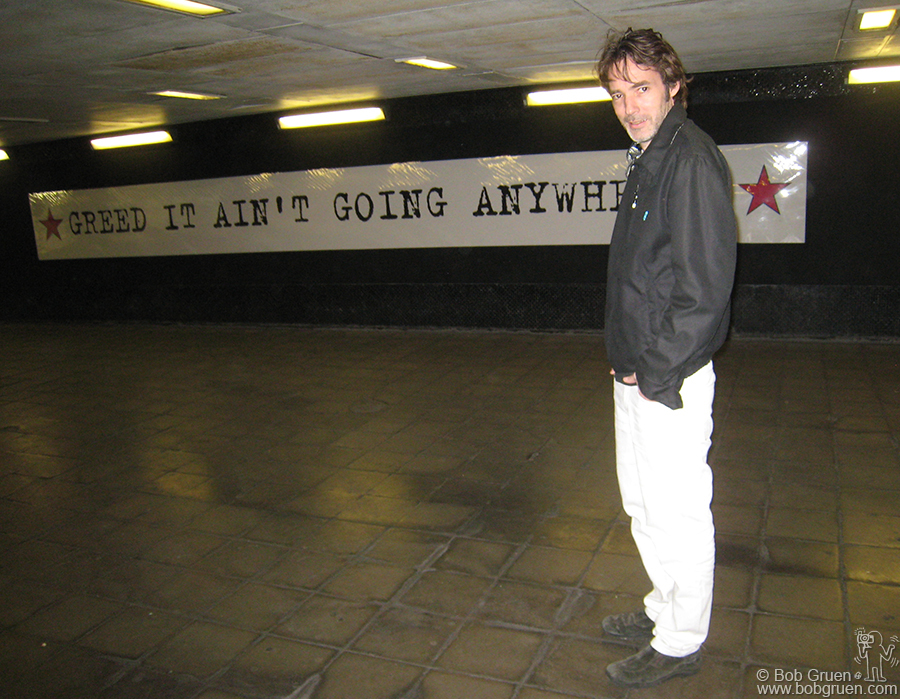 Sept 23 - London - Gordon McHarg showed me his 'Subway Gallery' at the underpass below Edgware Rd/Harrow Rd crossing in London, and I got a photo of him in front of the display he made of Joe Strummer's comment.