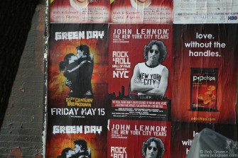 May 16 - Advertisements for Green Day's '21st Century Breakdown' and 'John Lennon: The New York City Years' at the Rock & Roll Hall of Fame Annex.