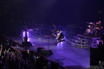 Bass player Mike Dirnt jumps high.