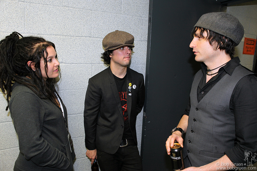Adrienne and Billie Joe hang with New York rocker Jesse Malin backstage after the show.