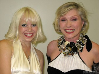 Backstage at the Living Theater benefit commedian Tammy Faye Starlite says hi to the event headliner Debbie Harry.