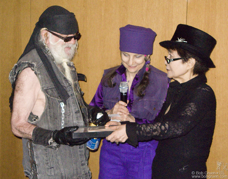 Feb 1 - NYC - Yoko Ono presents an award of recognition to La Monte Young at an event at the Museum of Modern Art in New York. La Monte Young is an avant garde musician who was a big inspiration for composer John Cale, and many others.