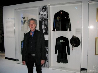A photo of me at the opening in front of the display of the T-shirt I gave to John Lennon for the now famous photo I took in 1974, now at the Rock & Roll Hall of Fame Annex. The show features many original writings and artwork by Lennon, as well as inspiring videos.