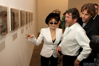 Yoko Ono explains some items in her exhibit to Rolling Stone publisher Jann Wenner.