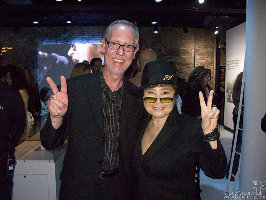 "May 11 - NYC - At Rock and Roll Hall of Fame's New York Annex, curator Jim Henke and Yoko Ono support peace at the opening of a new exhibit. Made with help from Yoko and titled ""John Lennon: The New York City Years"" it's well worth a visit."