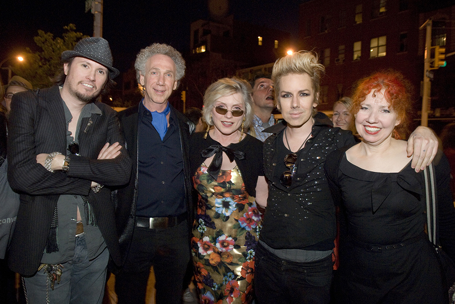 Michael Schmidt, Bob Gruen, Debbie Harry, Miss Guy and Snooky Bellomo get some air on the sidewalk out front. Photo by Linda Rowe.