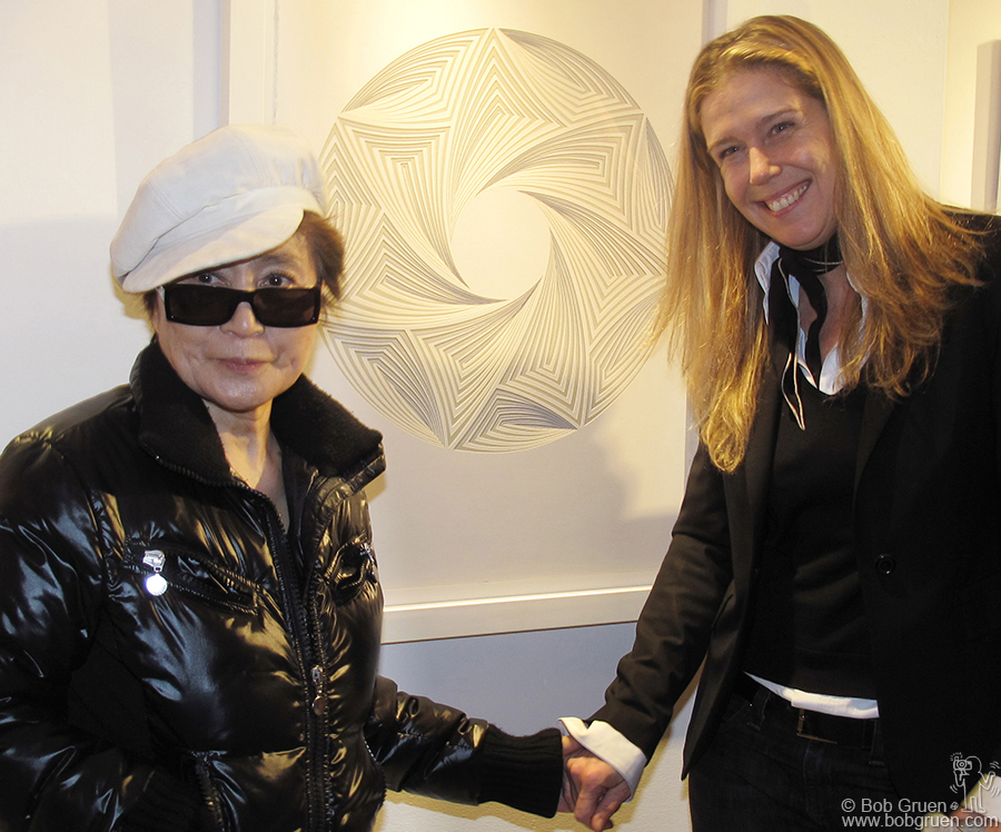 Jan 8 - NYC - Yoko Ono congratulates my wife, Elizabeth Gregory-Gruen at the opening of Elizabeth's multi-layer cut paper art show, in Chelsea. Yoko liked the piece behind them so much that she acquired it for her collection.