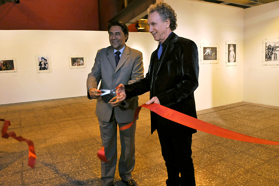 May 21 - Mexico City - Jorge Gutierrez, director of the Auditorio Nacional in Mexico City cuts the ribbon with Bob Gruen to open the exhibition of Bob's photos there. The exhibit will move to University of the State of Nuevo Leon in Monterrey, Mexico in the fall.