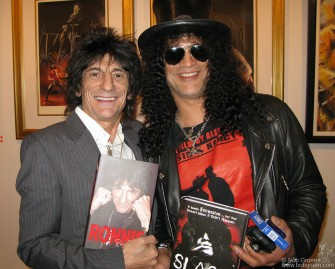 Nov 1 - Pop Gallery - New York - Ron Wood held an opening of his artwork and signed copies of his new book , and then Slash came by with his new book, and the rock and roll authors compared notes.