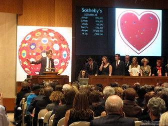 Feb 14 - Damien Hirst and Bono sponsored an auction of art at Sotheby's that raised over 40 million dollars to help fight AIDs in Africa.