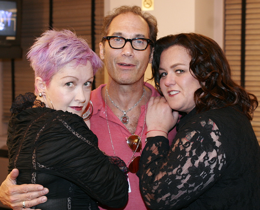 Cyndi Lauper and Rosie O'Donnell give a big hug of thanks for getting it all together to tour Agent/Promoter, Jonny Podell.