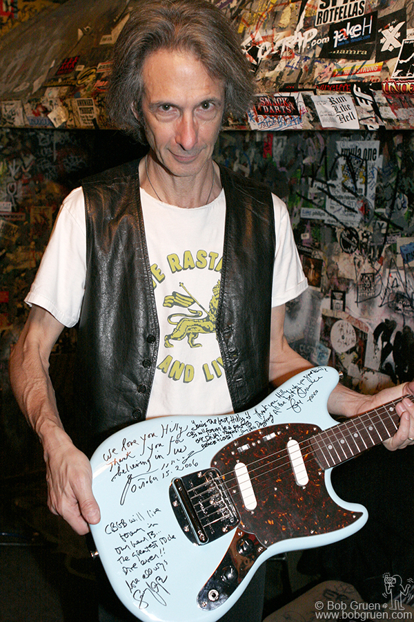 Lenny Kaye shows the guitar he and his bandmates signed as a thank you gift to Hilly.