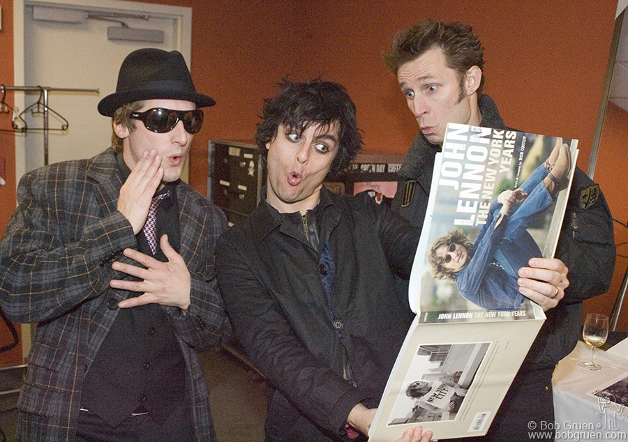 "Green Day taking a sneak peak at Bob's new book, ""John Lennon: The New York Years""."