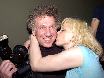 Backstage after the show, Kevin Mazur took some shots of me as Courtney said hello with a kiss.