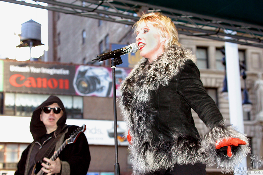 April 6 - NYC - Debbie sings with passion as Blondie rock the downtown area around NY City Hall.