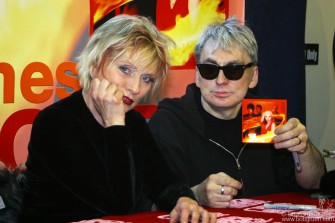 "Chris Stein joins Debbie and holds up the new CD "" The Curse of Blondie""."