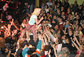 Courtney walks off the stage at the Bowery Ballroom as the fans hold her up.
