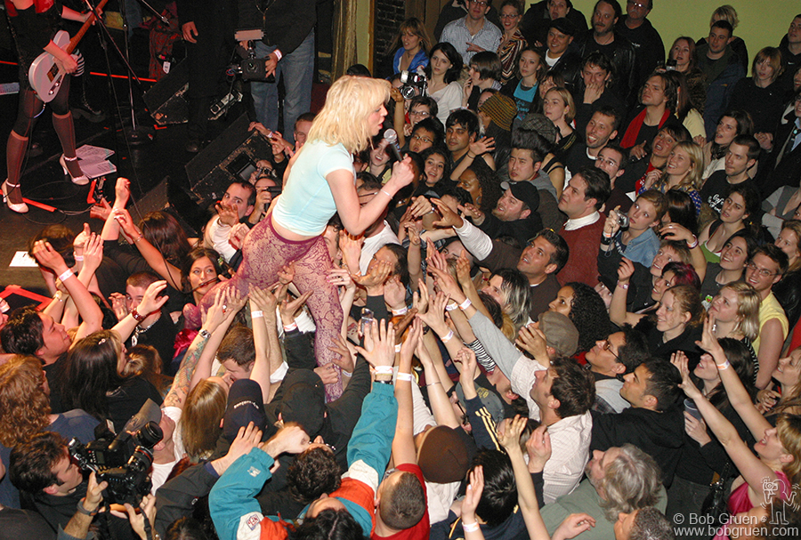 March 18 - NYC - Courtney walks off the stage at the Bowery Ballroom as the fans hold her up.