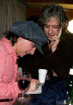 Sir Bob Geldof, himself a big Dolls fan, gets an autograph from Sylvain for his daughter.