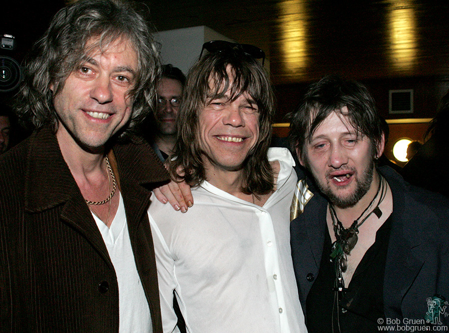 Sir Bob Geldof and David give a very smashed Shane McGowan a shoulder to lean on.