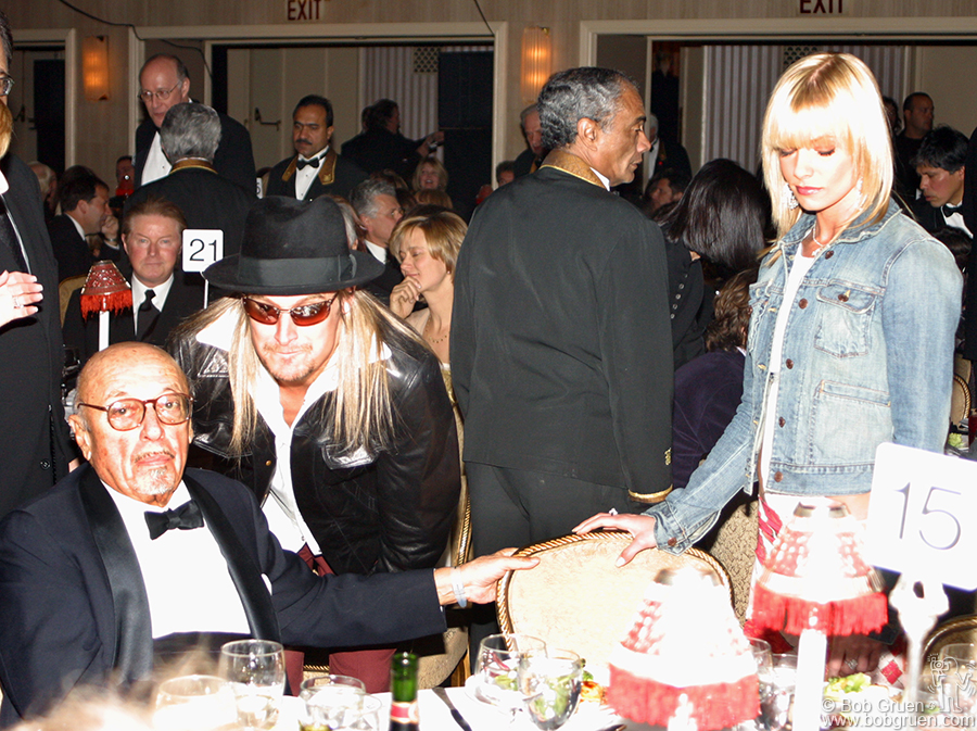 Kid Rock says hello to Ahmet Ertegun as Kid's date Jaime Presley takes her seat.