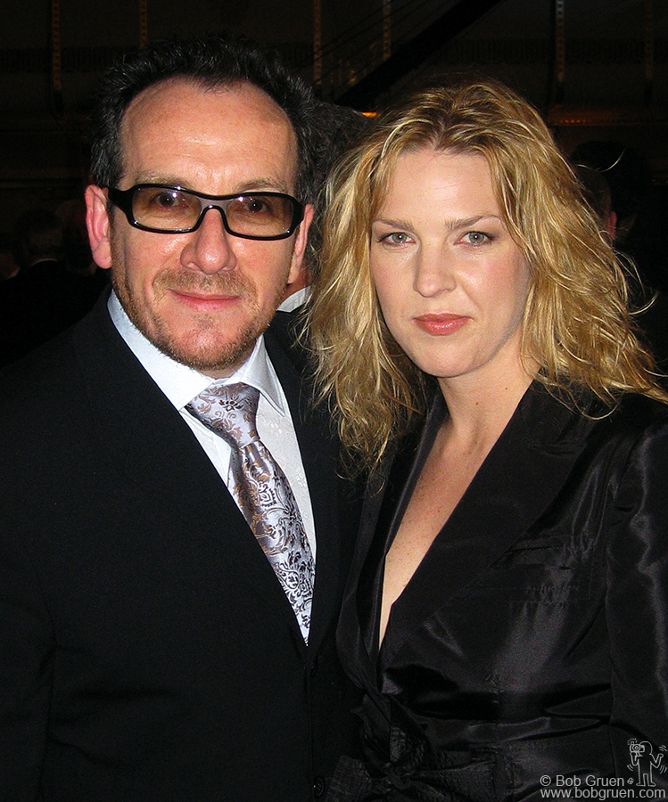 Elvis Costello, being inducted into the Hall of Fame with his first band The Attractions, arrives at the dinner with his new attraction, the lovely singer Diana Krall.