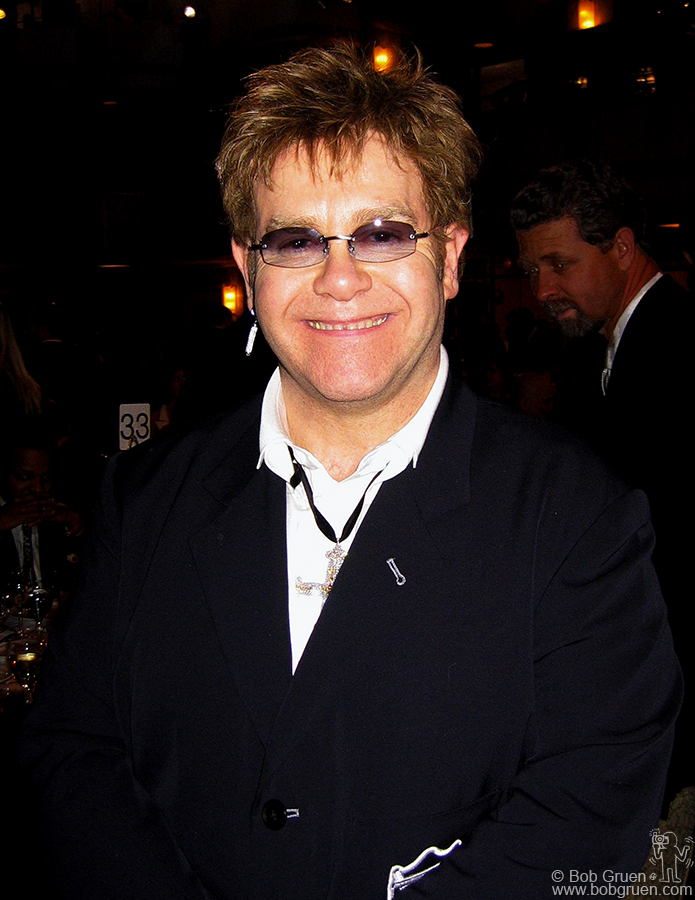 Sir Elton John looks happy as he arrives at the Waldorf.